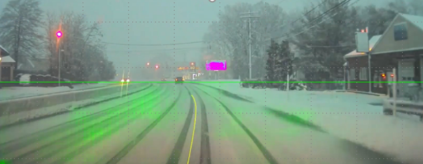 A screenshot of a snowy road with PilotNet trajectories overlaid.