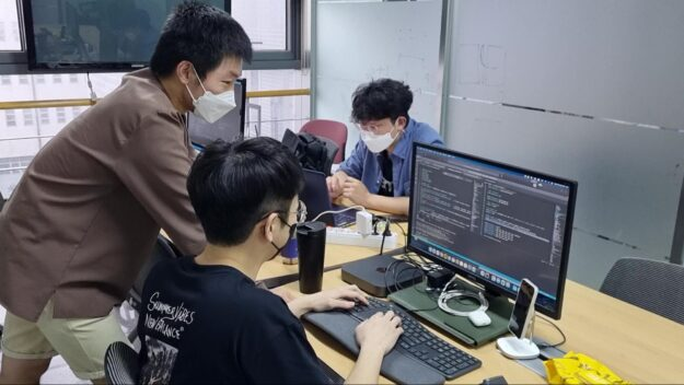 Image of people working at computer.