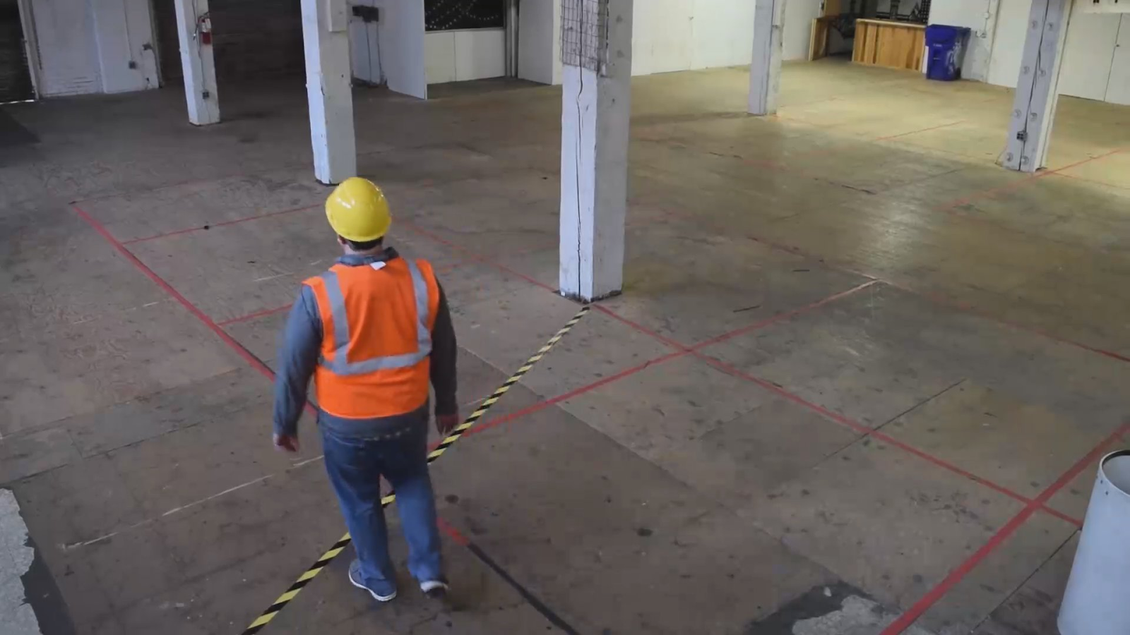 Image showing one camera snapshot captured with the media server, a worker walking around a restricted area.
